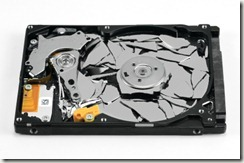 stock-photo-12632606-broken-hard-disk-drive